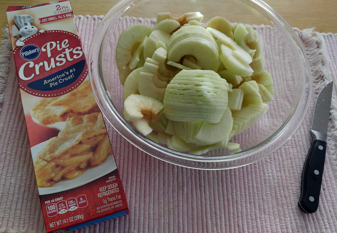 Slice apples and warm refrigerated pie dough to room temperature.