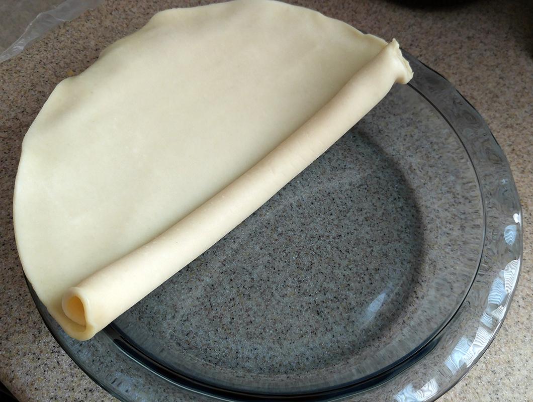 Roll pie crust into your pie pan.